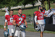 Carolina Panthers quarterbacks Taylor Heinicke (6) Kyle Allen (7) and Will Grier (3) take the field and wave to fans during training camp at Wofford College, Saturday, July 27, 2019, in Spartanburg, S.C. (Brian Villanueva/Image of Sport)
