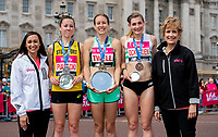Jess Piasecki (second place), Stephanie Twell (first place), and Verity Ockenden (third place) pose together on the podium alongside Dame Jess Ennis-Hill and Judy Parfitt, Director of People at Vitality, with their respective salvers in the British Championships 10,000 Road Race Women. <br /> <br /> Photo: Thomas Lovelock for The Vitality London 10,000<br /> <br /> For further information: media@londonmarathonevents.co.uk