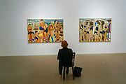 Interior of the Tel Aviv Museum of Arts. Tel Aviv, Israel. Visitor is studying artwork by Pamela Levy