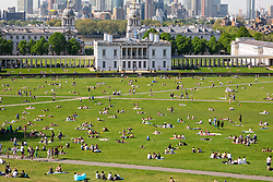© Licensed to London News Pictures. 07/05/2018. London, UK. Thousands of people enjoy the warm weather in Greenwich park on Bank Holiday Monday. Temperatures hit as high as 28.7 degrees C in the capital today, the hottest early May Bank Holiday on record. Photo credit : Tom Nicholson/LNP