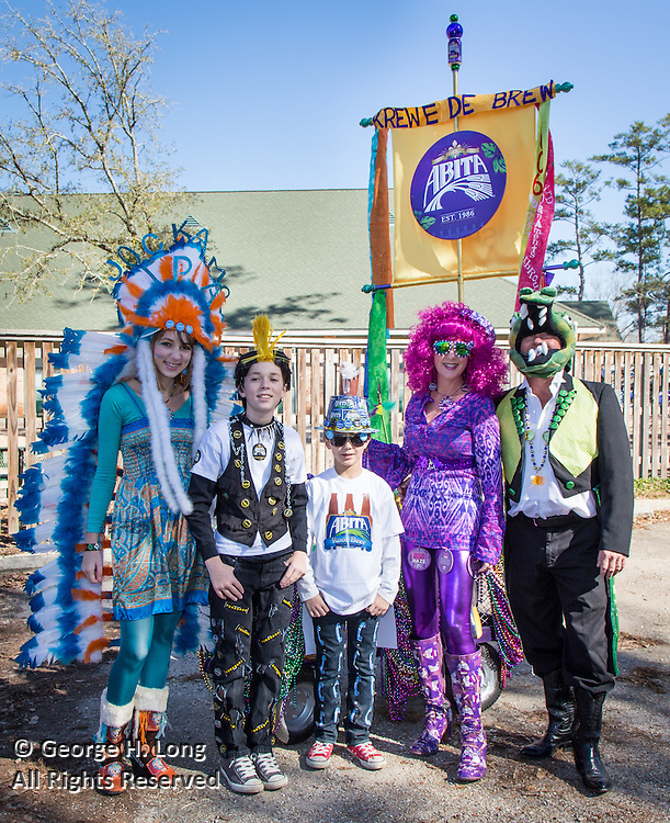 Before the Push Mow parade in Abita Springs; family of Before the Push Mow parade in Abita Springs; Sheri and John Campbell dressed as Abita Brewing Co. products: Jockamo, Turbodog, root beer, Purple Haze, and Andygator beer