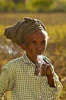 Woman smoking a pipe, Bagan, Myanmar (Burma)