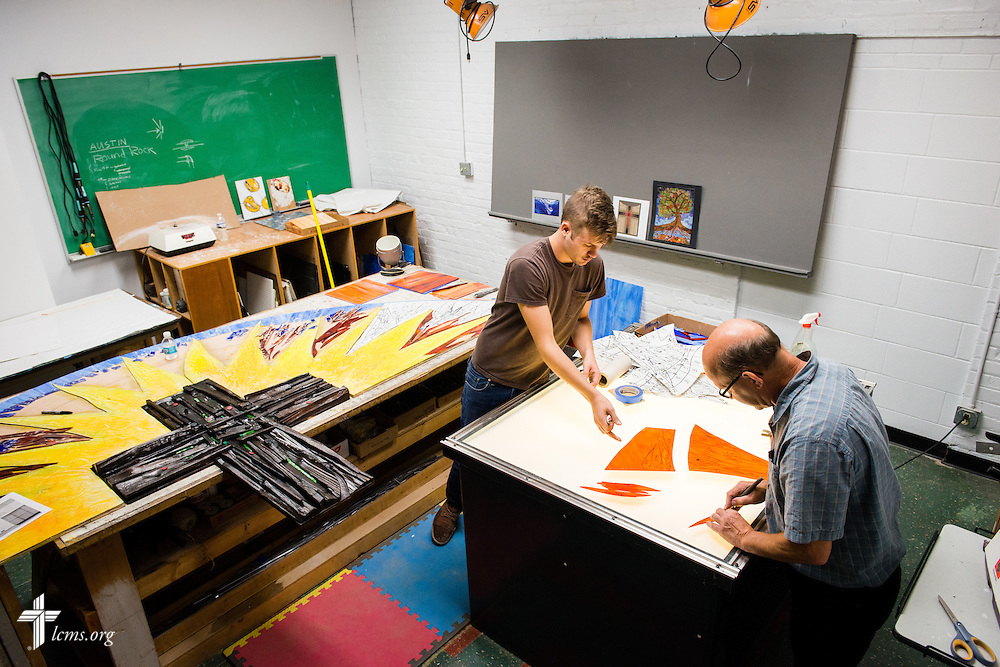 Student Austin Romine (center) and Mark Anschutz, managing artist at The Center for Liturgical Art, work on stained glass Monday, July 28, 2014, at Concordia University, Nebraska, in Seward, Neb. LCMS Communications/Erik M. Lunsford