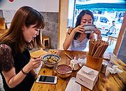 China, Sichuan. Chengdu. The best Dan Dan Mian (Dan Dan noodles), Jiangdou Mian (Cow Pea Noodles) and Hongyou Chaoshou (hot chili oil wontons) in town can be had at Chunyang Guanyuxiang Paigumian 纯阳馆鱼香排骨面.