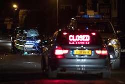 © Licensed to London News Pictures . 19/02/2017 . Liverpool , UK . A pedestrian , named as 89-year-old Andrew Oakden , has died in Aintree Hospital today (19th January 2017) after being in a collision with a minicab on Grange Lane in Gateacre, Liverpool , overnight (18th/19th February 2017) . Pictured: police examine the scene of the collision , on Grange Lane . Photo credit: Joel Goodman/LNP