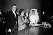 05/07/1967<br /> 07/05/1967<br /> 05 July 1967<br /> Wedding of George Walsh, eldest son of Mr and Ms Kevin G. Walsh, St. Rita's, Firhouse Road, Templeogue, Co. Dublin and Miss Arlene McMahon, elder daughter of Det. Chief Supt. Philip McMahon, Head of Special Branch, Dublin Castle and Mrs McMahon of Lisieux, Templeville Park, Templeogue, Co. Dublin who were married at the Carmelite Church, Terenure College, Dublin. An Taoiseach Mr Jack Lynch and Mrs Lynch; Mr Liam Cosgrave, leader Fine Gael and Mrs Cosgrave were among the 120 guests. Rev Fr H.E. Wright, O. Carm., Moate, officiated at the ceremony. The reception was held at Downshire Hotel, Blessington, Co. Wicklow. The couple sign the register watched by the Bride's parents.