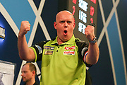 Michael van Gerwen wins fourth set 4th and celebrates by punching the air during the 2019 William Hill World Darts Championship Final at Alexandra Palace, London, United Kingdom on 1 January 2019.