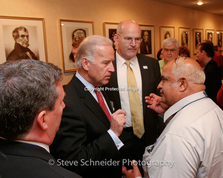 Vice-President Joe Biden listens to a council member backstage at a National League of Cities event in Washington, DC.