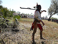 A man dressed like a Seminole soldier attends to the battle reenactments honor the Seminole's struggle and sacrifice to remain in their homeland on Saturday February 28, 2009 in Big Cypress Reservation. The three-day event will also include music, Seminole food, Seminole and pioneer artisans, tomahawk throws, primitive archery competition, authentic Seminole and soldier camps, venomous snake shows and alligator wrestling. On the recreation are used authentic weapons, soldier and warrior attire and tactics typical of the Second Seminole War.  Staff photo/Cristobal Herrera ....
