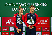 Grace Reid of Great Britain and Tom Daley of Great Britain smiling on the podium with their Gold Medals in the Mixed Syncronised 3m dive at the FINA/CNSG Diving World Series 2019 at London Aquatics Centre, London, United Kingdom on 19 May 2019.