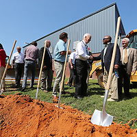 Supporters of the Savlation Army finish up the groundbreaking ceremony on Tuesday to officially begin constructin of the Jim Ingram Red Sheild Lodge in Tupelo.