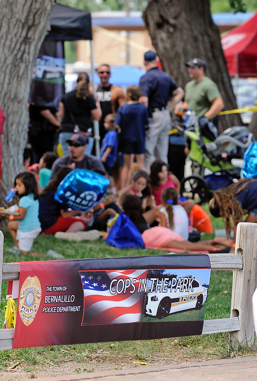 jt071417k/ a sec/jim thompson/People attend the Town of Bernalillo at Rotary Park in Bernalillo,NM  as they attended the Cops in the Park celebration. Friday,  July. 14, 2017. (Jim Thompson/Albuquerque Journal)