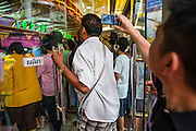 17 APRIL 2013 - BANGKOK, THAILAND:  People file into a gold shop in Bangkok to buy gold Wednesday. Thais flocked to gold shops in Bangkoks's Chinatown this morning to buy gold. Wednesday was the first day most gold shops were open after a five day holiday weekend. Shops were closed Friday through Tuesday, when global gold prices dropped by more than 13% based on jitters that Cyprus might liquidate its gold stocks. The Thailand Futures Exchange (TFEX) suspended trading of all gold and silver futures for a short time Tuesday morning because of instability in the market. Gold is now about 22 percent below the record peak of $1,920.30 an ounce set in September 2011. Thais buy gold as both jewelry and an investment, a hedge against inflation and financial failures. Bangkok's Chinatown district is the center of Thailand's gold trade.    PHOTO BY JACK KURTZ
