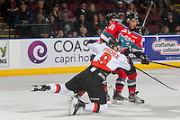 KELOWNA, CANADA - NOVEMBER 5: Zach Fischer #9 of the Medicine Hat Tigers is tripped up by Devante Stephens #21 of the Kelowna Rockets on November 5, 2016 at Prospera Place in Kelowna, British Columbia, Canada.  (Photo by Marissa Baecker/Shoot the Breeze)  *** Local Caption ***