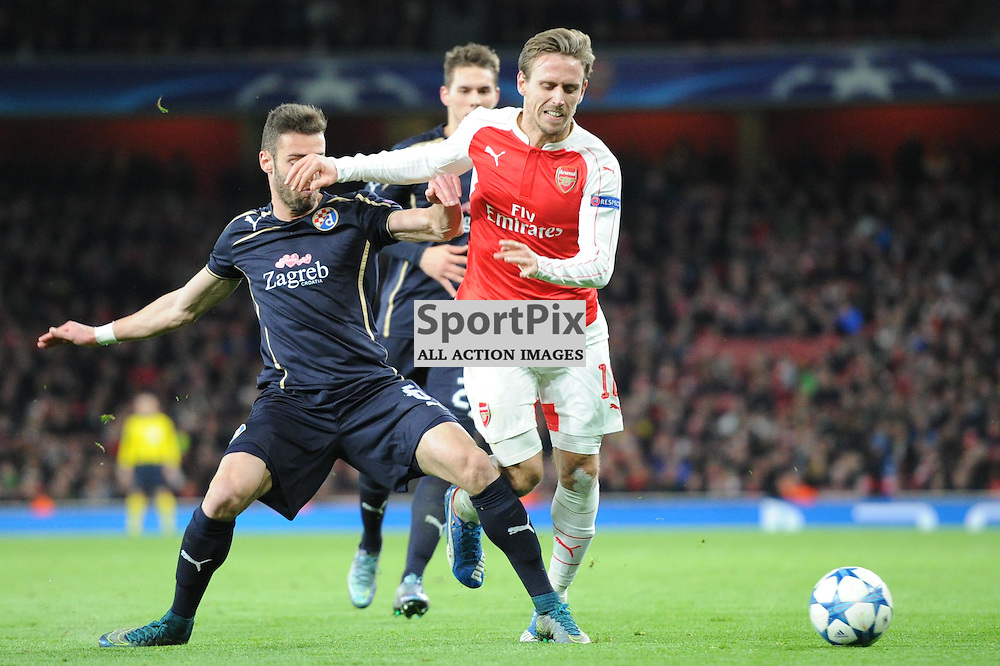 Arsenals Nacho Monreal and Dinamo Zagrebs Ivo Pinto in action during the Arsenal v Dinamo Zagreb game in the UEFA Champions League on the 24th November 2015 at the Emirates Stadium.