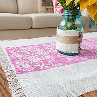 Burlap projects: Detail of stenciled runner and wrapped vase