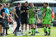 Forest Green Rovers manager, Mark Cooper and Forest Green Rovers Matt Mills(5) give instructions to Forest Green Rovers Carl Winchester(7) during the EFL Sky Bet League 2 match between Forest Green Rovers and Colchester United at the New Lawn, Forest Green, United Kingdom on 14 September 2019.