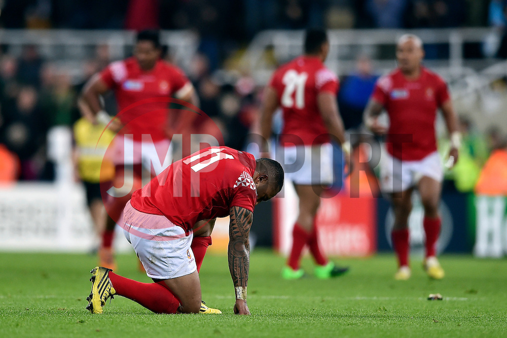 Fetu'u Vainikolo of Tonga takes a moment to himself after the match - Mandatory byline: Patrick Khachfe/JMP - 07966 386802 - 09/10/2015 - RUGBY UNION - St James' Park - Newcastle, England - New Zealand v Tonga - Rugby World Cup 2015 Pool C.