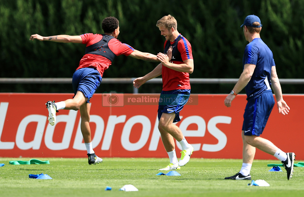 England's Deli Alli (left) Eric Dier and during the training session at Stade Omnisport.