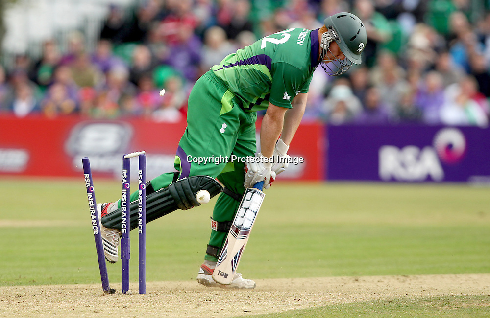 RSA Challenge ODI, Clontarf Cricket Club, Dublin, 25/8/2011<br />Ireland vs England<br />Ireland's Kevin O'Brien is bowled out by Jade Dernbach of England<br />Mandatory Credit &copy;INPHO/James Crombie  *** Local Caption ***