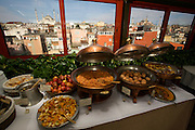 "Istanbul. Sultan Ahmed Mosque (""Blue Mosque"", Sultanahmet Camii) and Hagia Sophia (r.) Breakfast buffet at Armada Hotel."