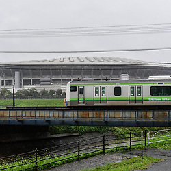 One of the last local trains before the complete suspension of the service due to the arrival of Typhoon Hagibis runs past the stadium that would have been the venue for the cancelled France v England match on October 12, 2019 in Yokohama, Japan. (Photo by Dave Winter/Icon Sport) - --- - International Stadium Yokohama - Yokohama (Japon)
