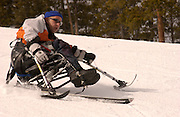 Alon Maori, from Israel, skis with a sit-ski at Winter Park through the National Center Sports Center for the Disabled, February 28, 2004.