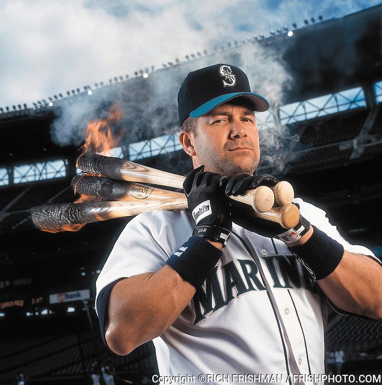 Portrait of Seattle Mariners' designated hitter Edgar Martinez with burning bats at Safeco Field in Seattle...©Rich Frishman.ALL RIGHTS RESERVED.This image is not to be published, printed, electronically disseminated or digitally archived without expressed written permission of the photographer.