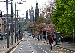 Edinburgh, Scotland, UK. 1 May 2020. Views of Edinburgh as coronavirus lockdown continues in Scotland. Streets remain deserted and shops and restaurants closed and many boarded up. Pictured; View of Princes Street with no traffic.  Iain Masterton/Alamy Live News
