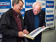 06 DECEMBER 2019 - DES MOINES, IOWA: US Senator BERNIE SANDERS (I-VT) autographs a yard sign for a campaign volunteer during a volunteer training session in Des Moines Friday. As the date of the Iowa caucuses approaches, many of the campaigns are ramping up their voter outreach efforts. The event was part of Sanders' campaign to be the Democratic presidential nominee in 2020. Iowa hosts the first selection event of the presidential election cycle. The Iowa Caucuses are Feb. 3, 2020.    PHOTO BY JACK KURTZ