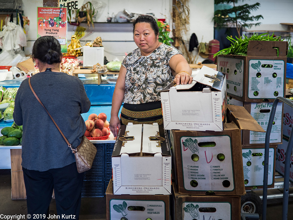 03 AUGUST 2019 - ST. PAUL, MINNESOTA: A vegetable vender at the Hmongtown Marketplace. Thousands of Hmong people, originally from the mountains of central Laos, settled in the Twin Cities in the late 1970s and early 1980s. Most were refugees displaced by the American war in Southeast Asia. According to the 2010 U.S. Census, there are now 66,000 ethnic Hmong in the Minneapolis-St. Paul area, making it the largest urban Hmong population in the world. There are two large Hmong markers in St. Paul. The Hmongtown Marketplace has are more than 125 shops, 11 restaurants, and a farmers' market in the summer. Hmong Village is newer and has more than 250 shops and 17 restaurants.     PHOTO BY JACK KURTZ