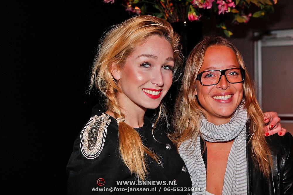 NLD/Amsterdam/20110128 - AIFW winter 2011, show Addy van den Krommenacker, Do, Dominique van Hulst en vriendin