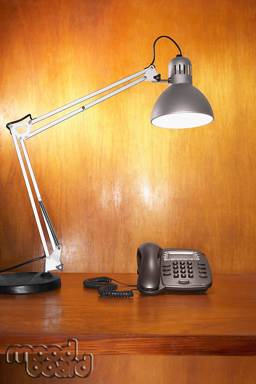 Lamp and telephone on desk