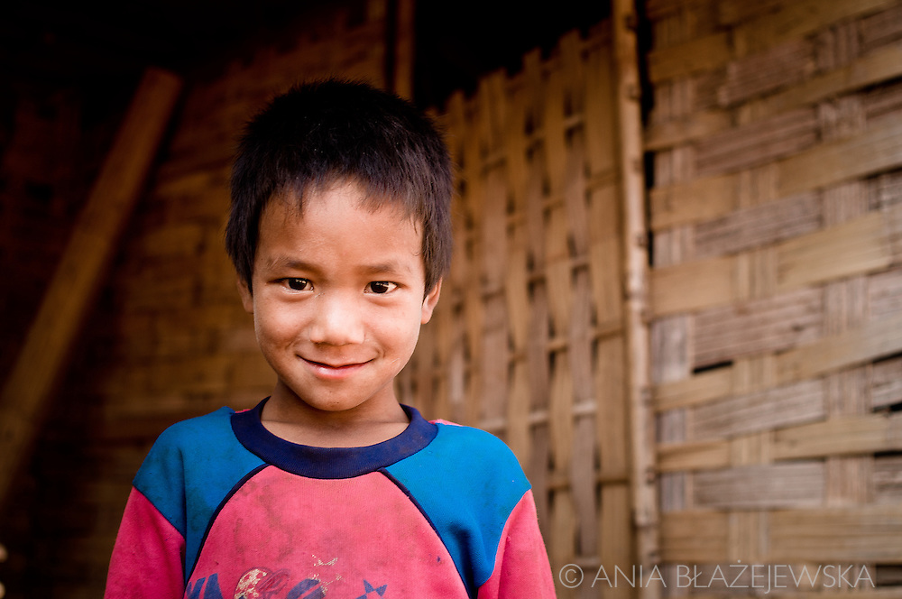 Laos, Muang Sing. Akha boy from one of the villages in the Muang Sing area.