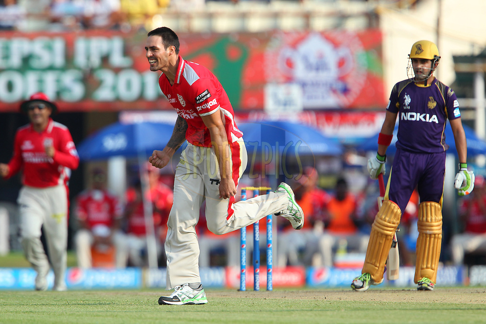 Mitchell Johnson of the Kings X1 Punjab celebrates the wicket of Gautam Gambhir captain of the Kolkata Knight Riders during the first qualifier match (QF1) of the Pepsi Indian Premier League Season 2014 between the Kings XI Punjab and the Kolkata Knight Riders held at the Eden Gardens Cricket Stadium, Kolkata, India on the 28th May  2014<br /> <br /> Photo by Ron Gaunt / IPL / SPORTZPICS<br /> <br /> <br /> <br /> Image use subject to terms and conditions which can be found here:  http://sportzpics.photoshelter.com/gallery/Pepsi-IPL-Image-terms-and-conditions/G00004VW1IVJ.gB0/C0000TScjhBM6ikg