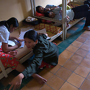 Students at the Provincial Teacher Training College in Siem Reap, Cambodia rest before their afternoon classes.  The school is free of charge for all who can pass an admission test, and it trains students to teach locally in Cambodia upon graduation.