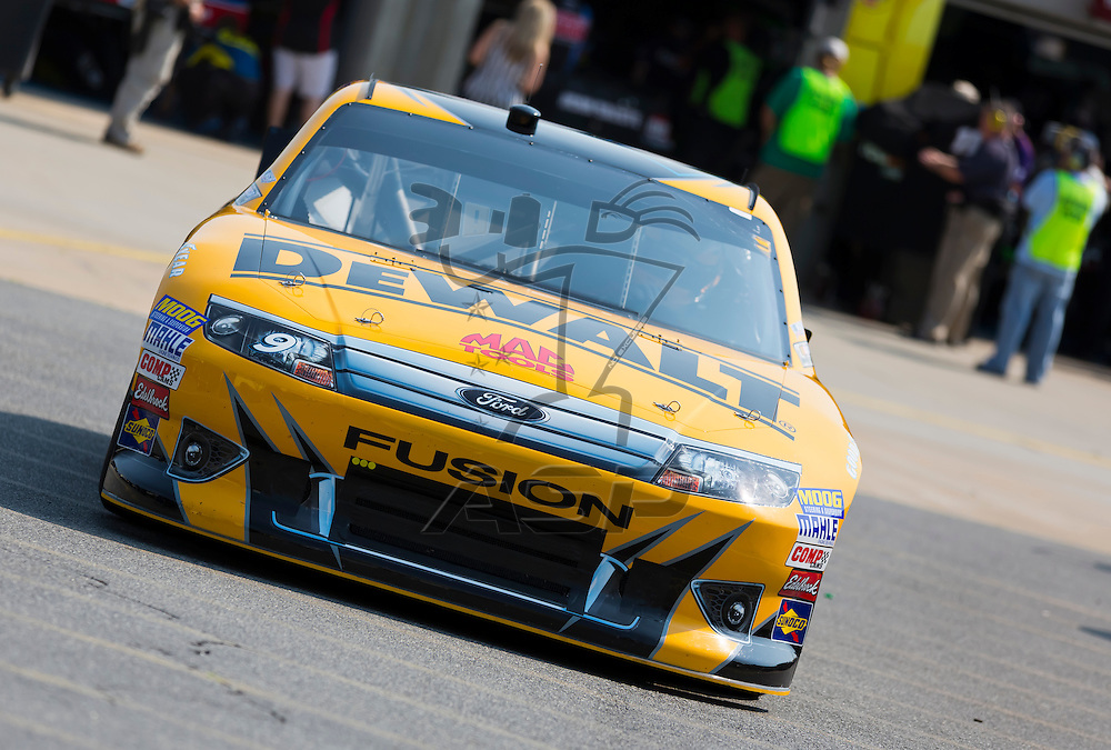 CONCORD, NC - MAY 26, 2012:  Marcos Ambrose (9) brings his DeWalt Ford Fusion on the track for a practice session for the Coca-Cola 600 at the Charlotte Motor Speedway in Concord, NC.