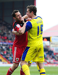 Sheffield Wednesday's Danny Pugh gets to grips with Bristol City's Sam Baldock  - Photo mandatory by-line: Joe Meredith/JMP - Tel: Mobile: 07966 386802 01/04/2013 - SPORT - FOOTBALL - Ashton Gate - Bristol -  Bristol City V Sheffield Wednesday - Npower Championship
