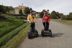 Couple on Segways, each on a Segway, on Angel Island State Park in San Francisco Bay, California, CA. Model released..Photo camari224-70567..Photo copyright Lee Foster, www.fostertravel.com, 510-549-2202, lee@fostertravel.com.