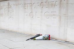Westminster, London, March 23rd 2017. Flowers laid outside Scotland Yard as investigations continue following Tuesday's terrorist attack on Westminster Bridge and in the grounds of Parliament, in which four people and their attacker were killed with over 40 injured.
