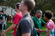 Ohio University President Roderick McDavis greets incoming freshmen as they pass through the college gate after the New Student Convocation on Aug. 24, 2014. Photo by Lauren Pond