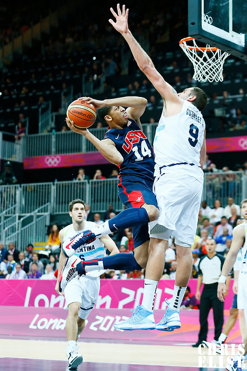 06 August 2012: USA Anthony Davis goes for the layup against Argentina Juan Pedro Gutierrez during 126-97 Team USA victory over Team Argentina, during the men's basketball preliminary, at the Basketball Arena, in London, Great Britain.