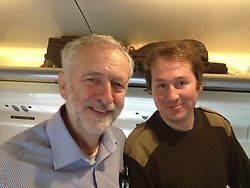 © Licensed to London News Pictures. 02/10/2015.  Labour leader JEREMY CORBYN talking to a group of women on a hen night out while on a train journey during his visit to Scotland yesterday (Thurs) Pictured here with Henry Bell who took the pictures..  Photo credit: Henry Bell/LNP