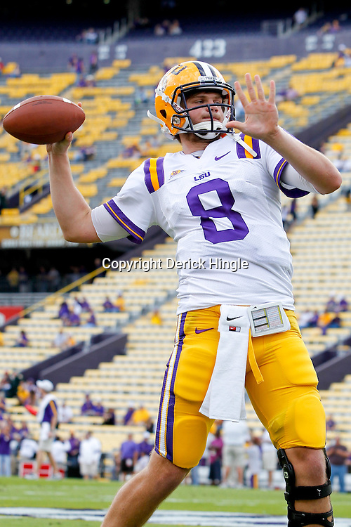 November 25, 2011; Baton Rouge, LA, USA; LSU Tigers quarterback Zach Mettenberger (8) against the Arkansas Razorbacks prior to kickoff of a game at Tiger Stadium. LSU defeated Arkansas 41-17. Mandatory Credit: Derick E. Hingle-US PRESSWIRE