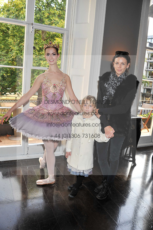 LIBERTY ROSS, her daughter SKYLA SAUNDERS and ballerina TESS BUCK at a children's tea party for the English National Ballet hosted by Mortons Private Members Club, Berkeley Square, London on 20th October 2011.