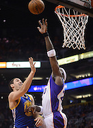 Apr 5, 2013; Phoenix, AZ, USA; Golden State Warriors guard Klay Thompson (11) is blocked by the Phoenix Suns center Jermaine O'Neal (20) in the first half at US Airways Center. Mandatory Credit: Jennifer Stewart-USA TODAY Sports
