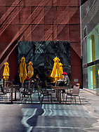 Reflected sun rays over a terrace at Au Bon Pain cafe on West 55th street in New York City