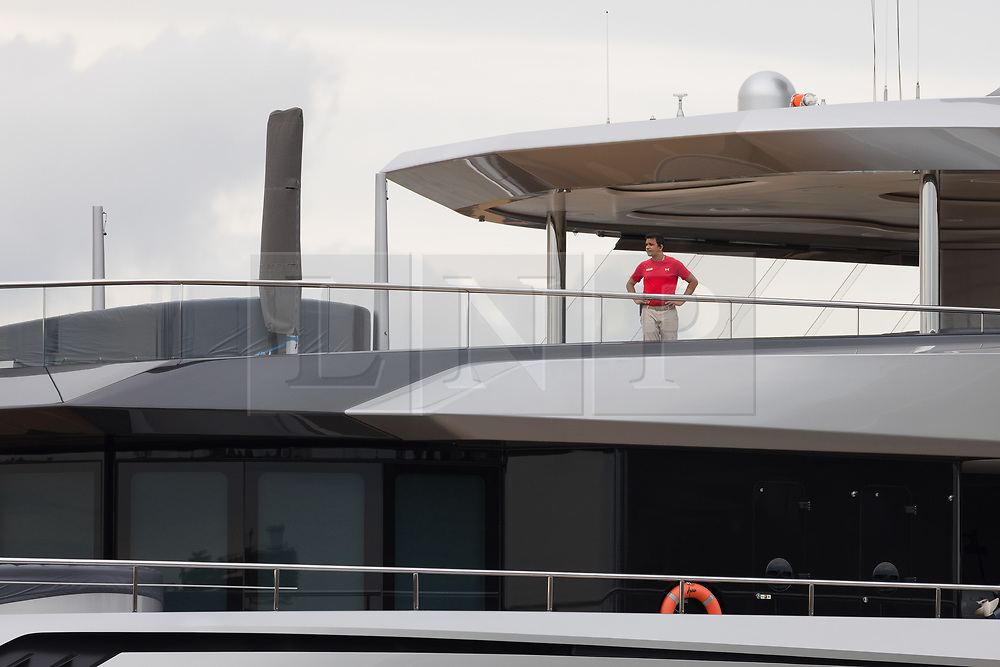 © Licensed to London News Pictures. 12/09/2018. London, UK.  A crew member on board Billionaire Spurs owner, Joe Lewis's 321 feet long luxury superyacht Aviva as it leaves London on the River Thames following a London visit. Aviva, worth an estimated £113m is one of a growing number of superyachts to visit the capital this year and moored near Butlers Wharf for a number of weeks, during which wealthy homeowners criticised the Spurs owner for spoiling their river view.  Photo credit: Vickie Flores/LNP