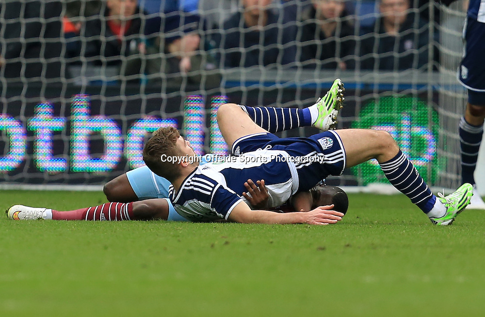 14th February 2015 - FA Cup 5th Round - West Bromwich Albion v West Ham United - James Morrison of West Bromwich Albion lands on top of Chiekhou Kouyate of West Ham United - Photo: Paul Roberts / Offside.