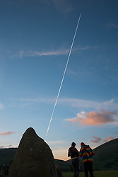 © Licensed to London News Pictures. <br /> 20/06/2014. <br /> <br /> Castlerigg Stone circle, Cumbria, England<br /> <br /> Visitors to the ancient site of Castlerigg Stone Circle near Keswick in Cumbria prepare to watch the sunset on the evening of the Summer Solstice.<br /> <br /> Photo credit : Ian Forsyth/LNP